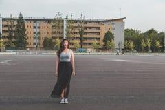 Beautiful curvy girl posing in an urban context Royalty Free Stock Photos