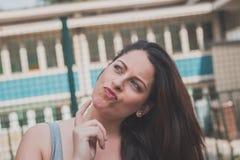 Beautiful curvy girl posing in an urban context Stock Photo