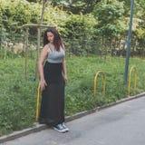 Beautiful curvy girl posing in an urban context Royalty Free Stock Photography