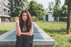 Beautiful curvy girl posing in an urban context Royalty Free Stock Photo