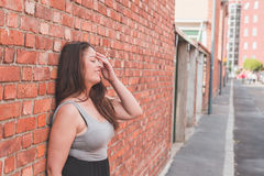 Beautiful curvy girl posing in an urban context Stock Photo