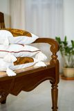 Beautiful cushion on wooden indoor seat. Stock Images
