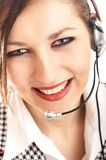 Beautiful Customer Representat. Ive with headset smiling during a telephone conversation - small DOF - focus mainly on the eyes and nose stock images