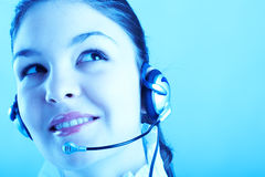 Beautiful Customer Representative. With headset smiling during a telephone conversation Royalty Free Stock Image