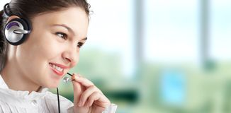 Beautiful Customer Representative. With headset smiling during a telephone conversation Stock Images