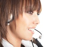 Beautiful Customer Representative. With headset smiling during a telephone conversation Stock Image