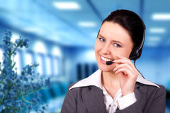 Beautiful customer representative. With headset smiling during a telephone conversation stock photo