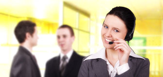 Beautiful customer representative. With headset smiling during a telephone conversation royalty free stock photos
