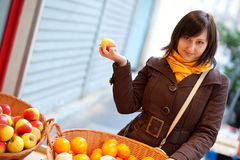 Beautiful customer selecting apples at market Stock Images