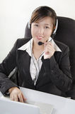 Beautiful customer service agent in call center Stock Images