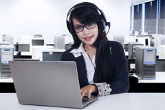 Beautiful customer service with laptop Stock Photography