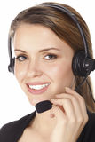 Beautiful customer service operator. Woman with headset, isolated on white background Stock Images