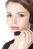 Beautiful customer service operator. Woman with headset, isolated on white background Royalty Free Stock Images