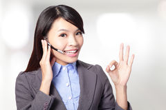 Beautiful customer service operator woman with headset Stock Photos