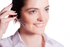 Beautiful customer service operator woman with headset Stock Photography
