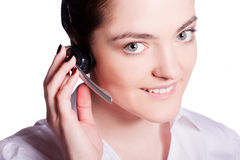 Beautiful customer service operator woman with headset Royalty Free Stock Photography