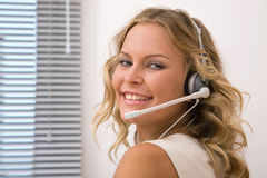 Beautiful customer service representative Royalty Free Stock Image
