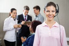 Beautiful Customer Service Representative Standing Royalty Free Stock Photo