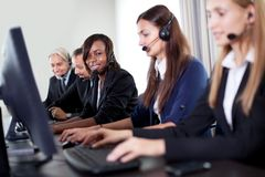 Beautiful customer service woman with her team Royalty Free Stock Images