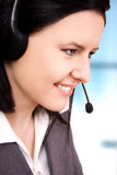 Beautiful customer support girl. Business customer support girl with a headset in an office royalty free stock image