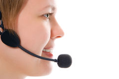 Beautiful customer support girl in headphones in half face. On white background stock photo