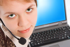 Beautiful customer support girl with laptop in headphones. On white background royalty free stock photo