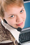 Beautiful customer support girl with laptop in headphones and microphone. On white background royalty free stock image