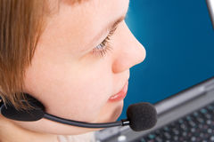 Beautiful customer support girl with laptop in headphones and microphone. On white background royalty free stock images