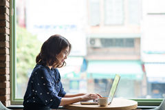 Beautiful cute asian young businesswoman in the cafe, using lapt Stock Images