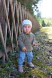 Beautiful and cute baby boy walking in park Stock Photos