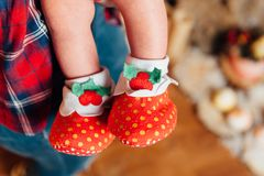Beautiful cute baby feet in socks royalty free stock images