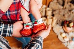 Beautiful cute baby feet in socks stock photography
