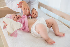 Beautiful cute baby girl with doctor with stethoscope Stock Photos