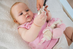 Beautiful cute baby girl with doctor with stethoscope Stock Photo
