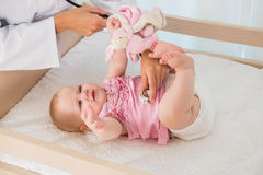 Beautiful cute baby girl with doctor with stethoscope Royalty Free Stock Photography