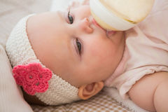 Beautiful cute baby girl drimking her baby bottle Royalty Free Stock Photography