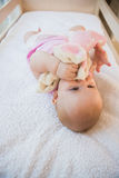 Beautiful cute baby girl in her crib Royalty Free Stock Image