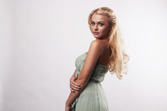 Beautiful cute blond woman in blue dress Royalty Free Stock Photo
