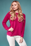 Beautiful cute blond woman in purple sweater Royalty Free Stock Photography