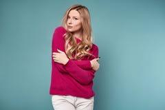 Beautiful cute blond woman in purple sweater Stock Photo