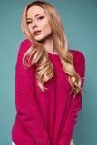 Beautiful cute blond woman in purple sweater Royalty Free Stock Photos