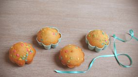 Beautiful cute Easter cupcakes on wood background while cooking stock photo