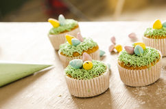 Beautiful cute Easter cupcakes with Easter decorations Stock Photos