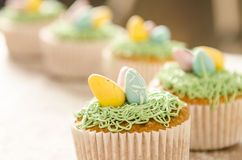 Beautiful cute Easter cupcakes with Easter decorations Stock Image