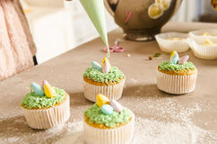 Beautiful cute Easter cupcakes with Easter decorations Stock Photo