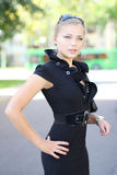 Beautiful cute girl in a black dress royalty free stock photography