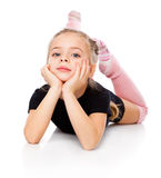 A beautiful cute girl is engaged in acrobatics Royalty Free Stock Images