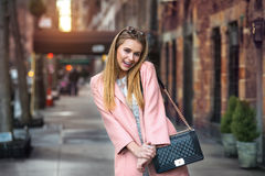 Beautiful cute girl having in good mood having fun in the city Stock Images