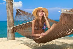 Beautiful cute girl relaxing in a hammock Royalty Free Stock Photography