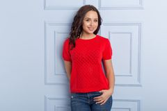 Beautiful cute girl with a smile demonstrates knitted clothes. Beautiful cute girl with a  smile demonstrates knitted clothes royalty free stock photo